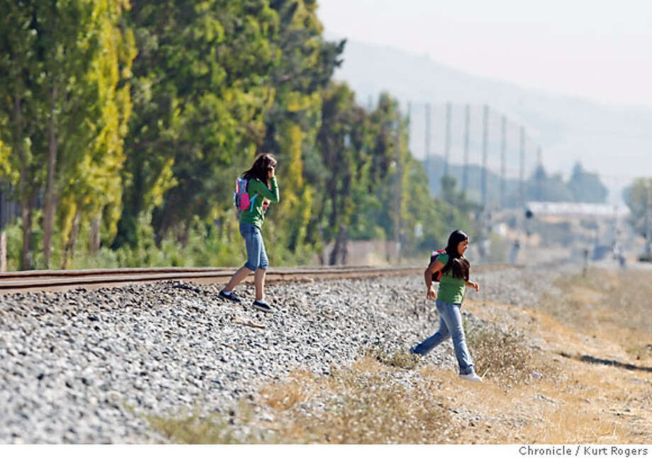 Bratnie Bumgarner 13 and Marlee Martinez 14 cross the tracks where a person was killed earlier in the day they set out to look for the spot where the accident occurred .  A sixteen year old from Tennyson High School was killed by an Amtrak train crossing the tracks on Tennson Road. TRAIN_085_KR.jpg  Kurt Rogers / The Chronicle Photo taken on 9/26/07, in San Francisco, CA, USA Photo: Kurt Rogers