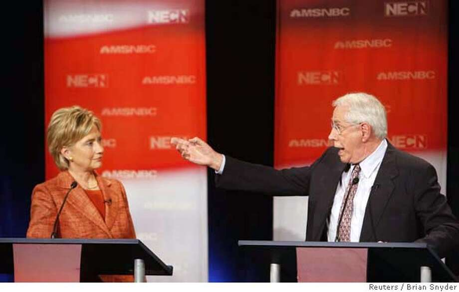 Former U.S. Senator Mike Gravel (D-AK ) (R) gestures towards U.S. Senator Hillary Clinton (D-NY) as he speaks during their debate at Dartmouth College in Hanover, New Hampshire September 26, 2007. REUTERS/Brian Snyder (UNITED STATES) 0 Photo: BRIAN SNYDER