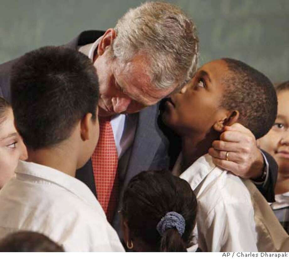 """An unidentified student whispers into President Bush's ear as the president gathered with fourth and fifth graders from P.S. 76 in the Bronx, Wednesday, Sept. 26, 2007, after the president made a statement about """"No Child Left Behind"""". (AP Photo/Charles Dharapak) Photo: Charles Dharapak"""