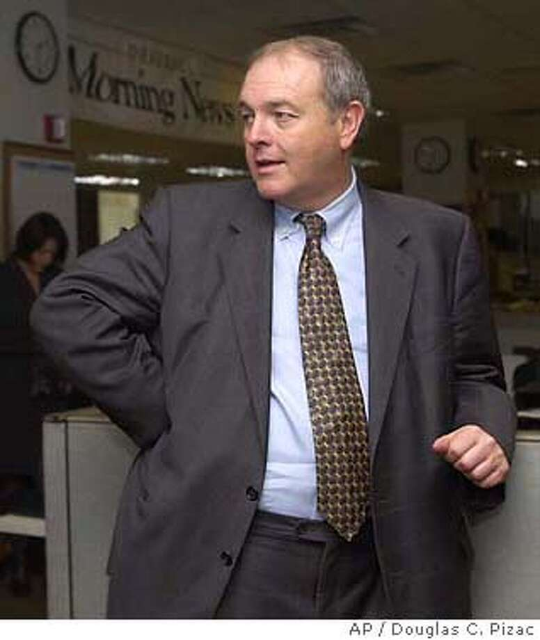 Deseret Morning News board chairman Glenn Snarr, left, and MediaNews president Dean Singleton answer questions during the introduction of former Cincinnati Enquirer president and publisher Harry Whipple to the editorial staff of the Deseret Morning News in his new role as president of the Newspaper Agency Corporation, Monday, Feb. 23, 2004, in Salt Lake City. The NAC handles the advertising and circulation of the paper and that of The Salt Lake Tribune. Singleton is also publisher of the Tribune. (AP Photo/Douglas C. Pizac)