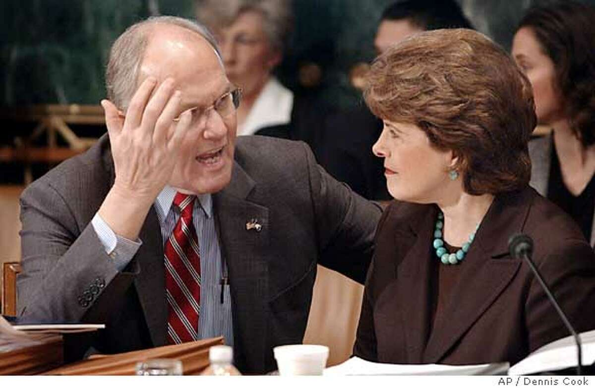 Sen, Larry Craig, R-Idaho, left, and Sen. Dianne Feinstein, D-Calif., confer as the Senate Judiciary Committee considers immigration legislation during a mark-up hearing on Capitol Hill Monday, March 27, 2006. (AP Photo/Dennis Cook)