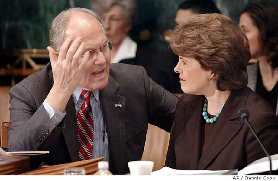 Sen, Larry Craig, R-Idaho, left, and Sen. Dianne Feinstein, D-Calif., confer as the Senate Judiciary Committee considers immigration legislation during a mark-up hearing on Capitol Hill Monday, March 27, 2006. (AP Photo/Dennis Cook) Photo: DENNIS COOK