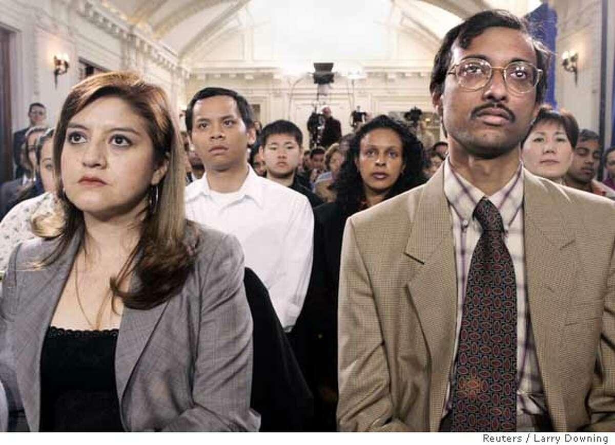 New US citizens listen to US President Bush speak in Washington