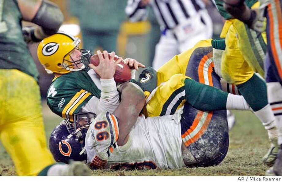 Chicago Bears' Tank Johnson sacks Green Bay Packers quarterback Brett Favre during the fourth quarter of their NFL football game on Sunday, Dec. 25, 2005, in Green Bay, Wis. The Bears won 24-17 to clinch the NFC North division. (AP Photo/Mike Roemer) Ran on: 12-26-2005 Ran on: 12-26-2005  Packers quarterback Brett Favre goes in the tank, as Tank Johnson of the Bears sacks him in the fourth quarter. Photo: MIKE ROEMER