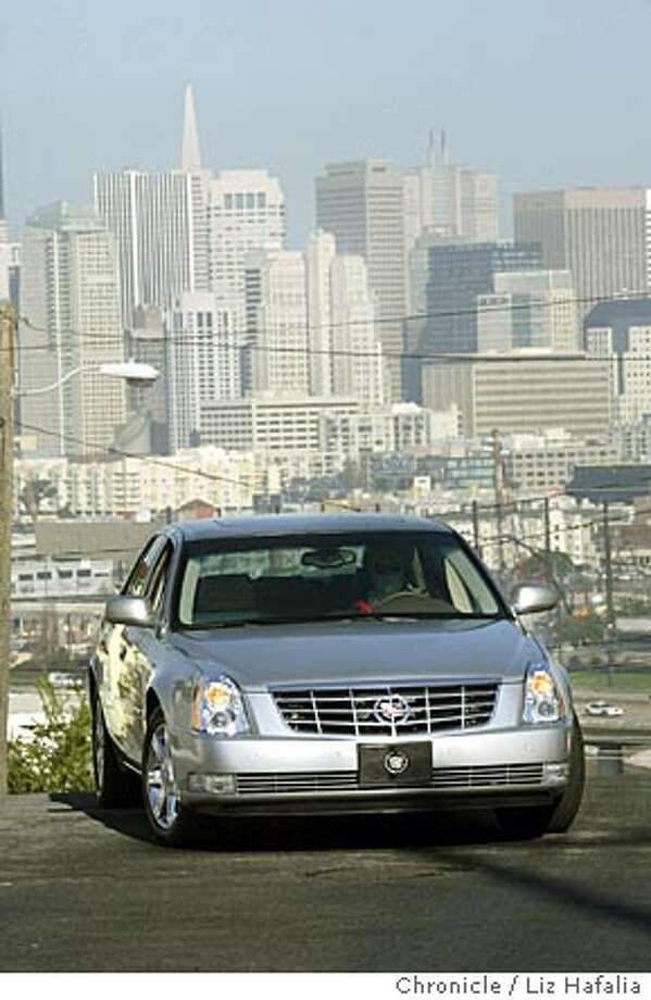 Review of a silver cadillac sedan.  Photographed by Liz Hafalia on 1/4/06 in San Francisco, California. SFC Photo: Liz Hafalia