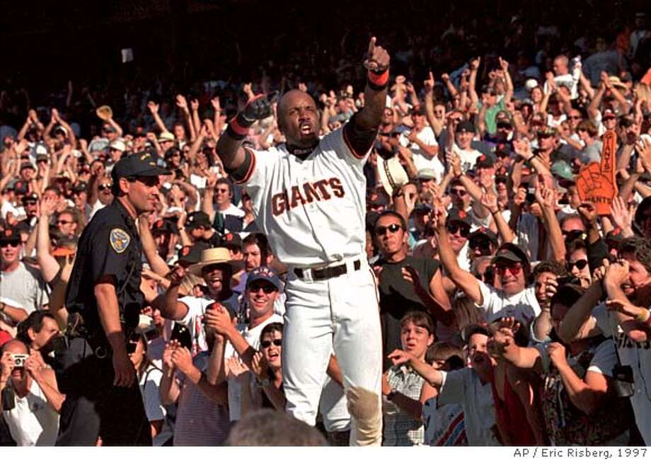 ** FILE ** San Francisco Giants Barry Bonds celebrates on top of the Giants dugout after they beat the San Diego Padres to win the National League West title in San Francisco, in this Sept. 27, 1997 file photo. The Giants won the game, 6-1, and won their first playoff berth since 1989. (AP Photo/Eric Risberg) A SEPT. 27, 1997 FILE PHOTO Photo: ERIC RISBERG