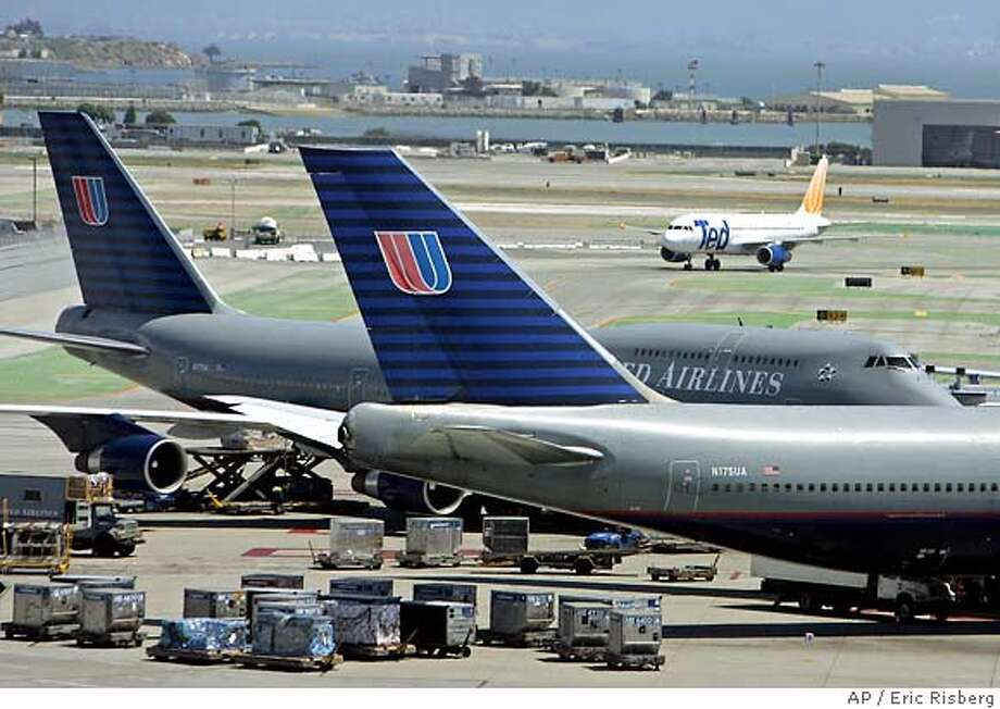 ** FILE ** A pair of United Airlines' Boeing 747's are parked at the international terminal as a United Airlines' Ted airplane passes in the background at San Francisco International Airport, in a file photo from June 22, 2005. Boeing Co. has agreed to pay $30 million to settle a lawsuit by residents who alleged that pollutants from a company lab caused them to get cancer. (AP Photo/Eric Risberg, File) Ran on: 01-28-2006  A pair of United Airlines Boeing 747s park at SFO as a United Airlines' Ted airliner passes in the background. JUNE 22, 2005 FILE PHOTO Photo: ERIC RISBERG