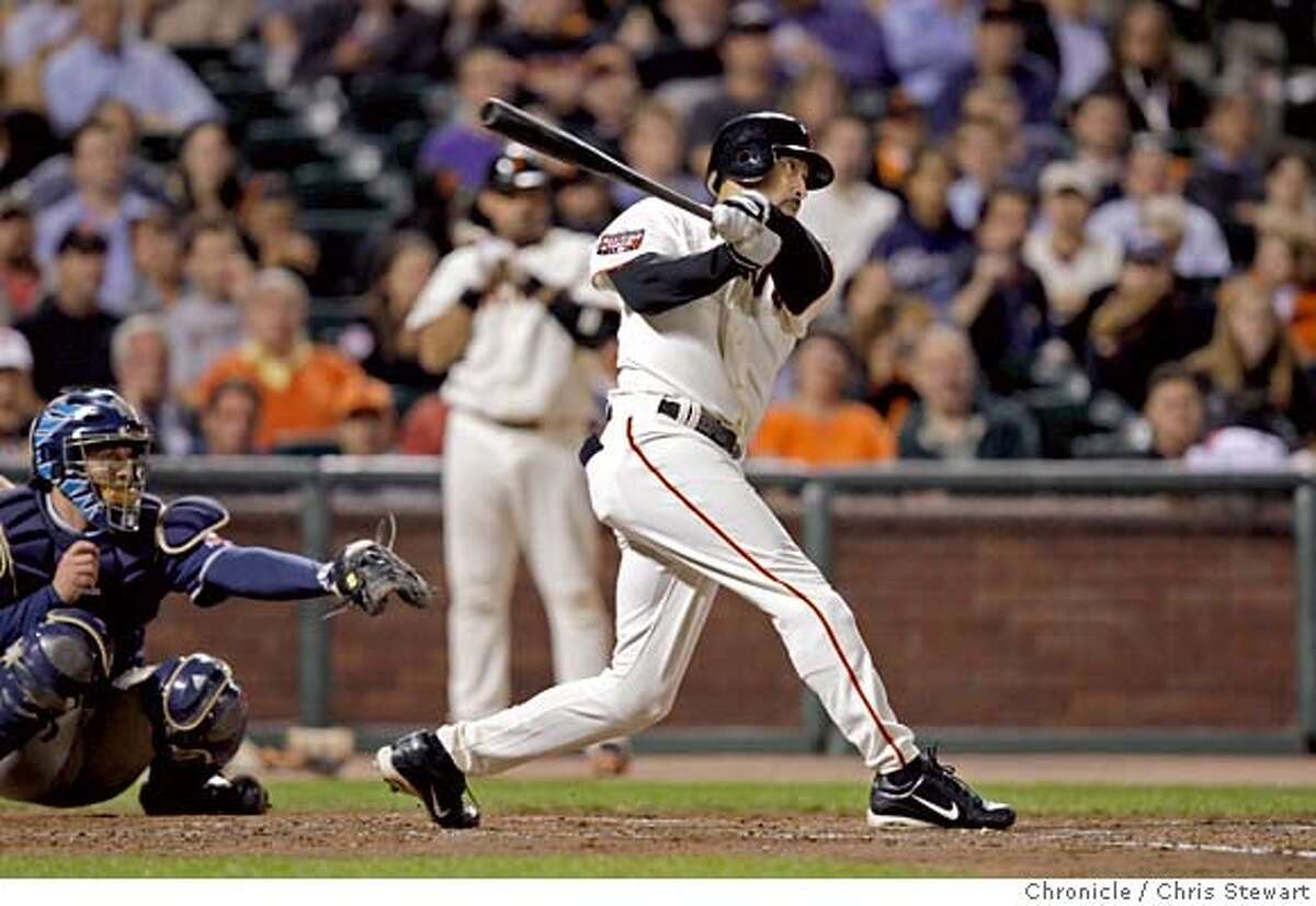 Event on 9/25/07 in San Francisco The San Francisco Giants' Randy Winn hits a two-run homer go over the center field fence in the second inning to put the Giants up 4-0 against the San Diego Padres at AT&T Park in San Francisco. Photographed September 25, 2007. Chris Stewart / The Chronicle San Francisco Giants, San Diego Padres