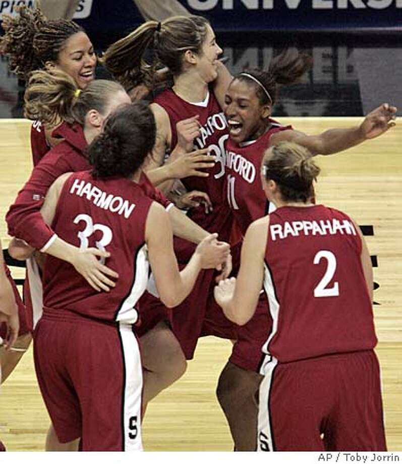 Stanford center Brooke Smith (30) and guard Candice Wiggins celebrate with teammates Jullian Harmon (33) and Krista Rappahahn (2) after beating Oklahoma 88-74 in the NCAA Women's Regional semifinal basketball game in San Antonio, Saturday, March 25, 2006. (AP Photo/Toby Jorrin) Photo: TOBY JORRIN