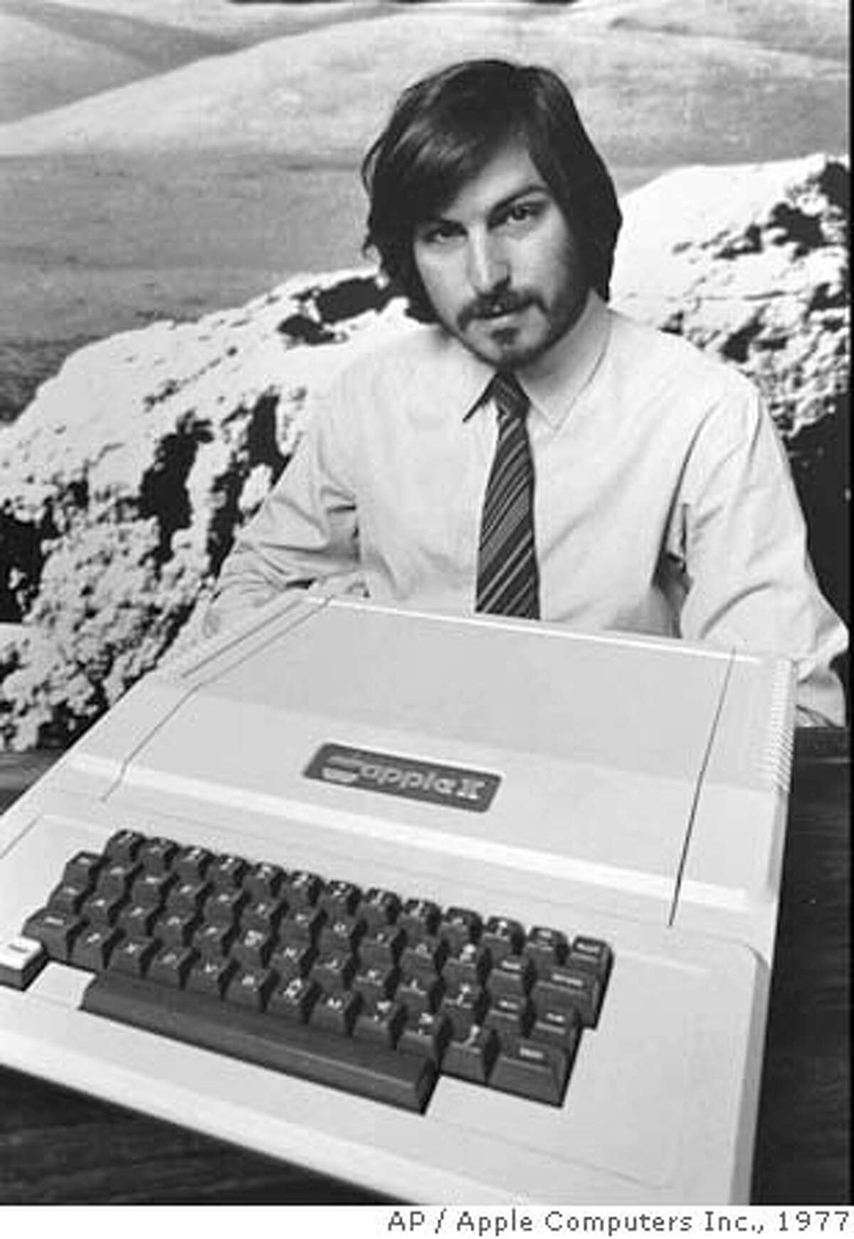 This is a 1977 photo of Apple Computer Inc. founder Steve Jobs as he introduces the new Apple II in Cupertino, Calif. Apple Computer was formed 20 years ago, on April Fool's Day in 1976. (AP Photo/Apple Computers Inc., file) Ran on: 01-09-2006