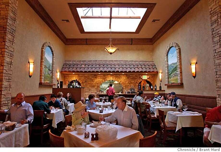DINE26_spasso_202.JPG  This popular restaurant was almost full during a mid-week visit.  Spasso restaurant on Laurel Street in San Carlos features a large dining room with a large skylight and Mediterranean paintings on the walls. {By Brant Ward/San Francisco Chronicle}9/18/07 Photo: Brant Ward