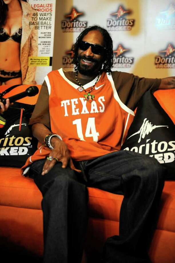 Snoop DoggVeteran West Coast rapper Snoop Dogg is another unapologetic inhaler. When he was arrested in Sierra Blanca in January 2012, authorities said he freely admitted the joints they found on his tour bus were his. And he apparently had no hard feelings, proudly showing his Texas colors when he made a publicity appearance in Austin two months later. Photo: AP Images For Doritos