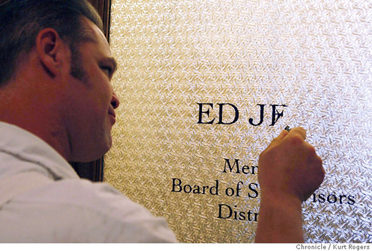 Douglas the City Hall painter (he wouldn't give me his last name) removed Ed Jews name from Ed's office door in City Hall this morning during a press conference in the mayor's office. San Francisco, CA, on Tuesday, September, 25. photo taken: 9/25/07 KURT ROGERS / The Chronicle *