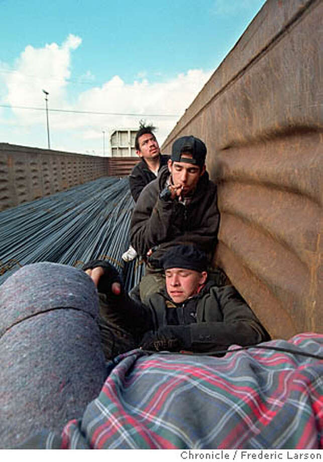 Homeless young adults ride a freight train in Oakland heading for Phoenix in the late 1990s. Once the fading province of hoboes, riding free in a freight car has undergone a revival for everyone from immigrants to middle-class thrill-seekers. Chronicle file photo, 1998, by Frederic Larson