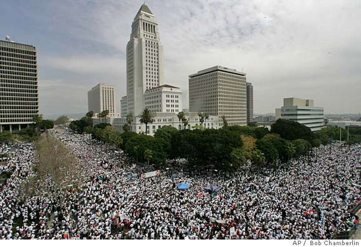 Demonstrators march to protest federal immigration legislation around City Hall in Los Angeles, Saturday March 25, 2006. The U.S. House of Represenatives passed HR 4437 bill that would make it a felony to be in the U.S. illegally, impose new penalties on employers who hire illegal immigrants and erect fences along one-third of the U.S.-Mexican border. The Senate is to begin debating the proposals on Tuesday. (AP Photo//Los Angeles Times, Bob Chamberlin) **MANDATORY CREDIT BOB CHAMBERLINJ/LOS ANGELES TIMES NO MAGS OUT, NO FOREIGN NO TELEVISION** MANDATORY CREDIT BOB CHAMBERLINJ/LOS ANGELES TIMES NO MAGS OUT, NO FOREIGN NO TELEVISION. LOS ANGELES DAILY NEWS, ORANGE COUNTY REGISTER, VENTURA COUNTY STAR, INLAND VALLEY DAILY BULLETIN AND SAN BERNARDINO SUN OUT. PROTEST AGAINST HOUSE-PASSED