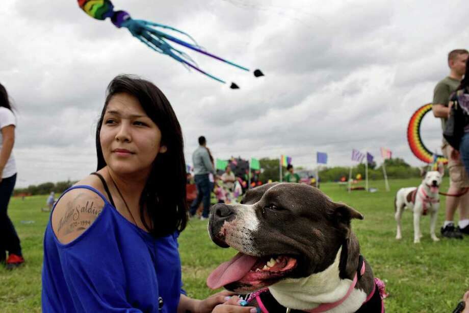 "Mara Saldivar sits with her dog, Brina, during ""Fest of Tails,"" the 6th annual Kite Festival and Dog Fair at McAllister Park in San Antonio on Saturday, March 17, 2012. Photo: Lisa Krantz, San Antonio Express-News / @San Antonio Express-News"