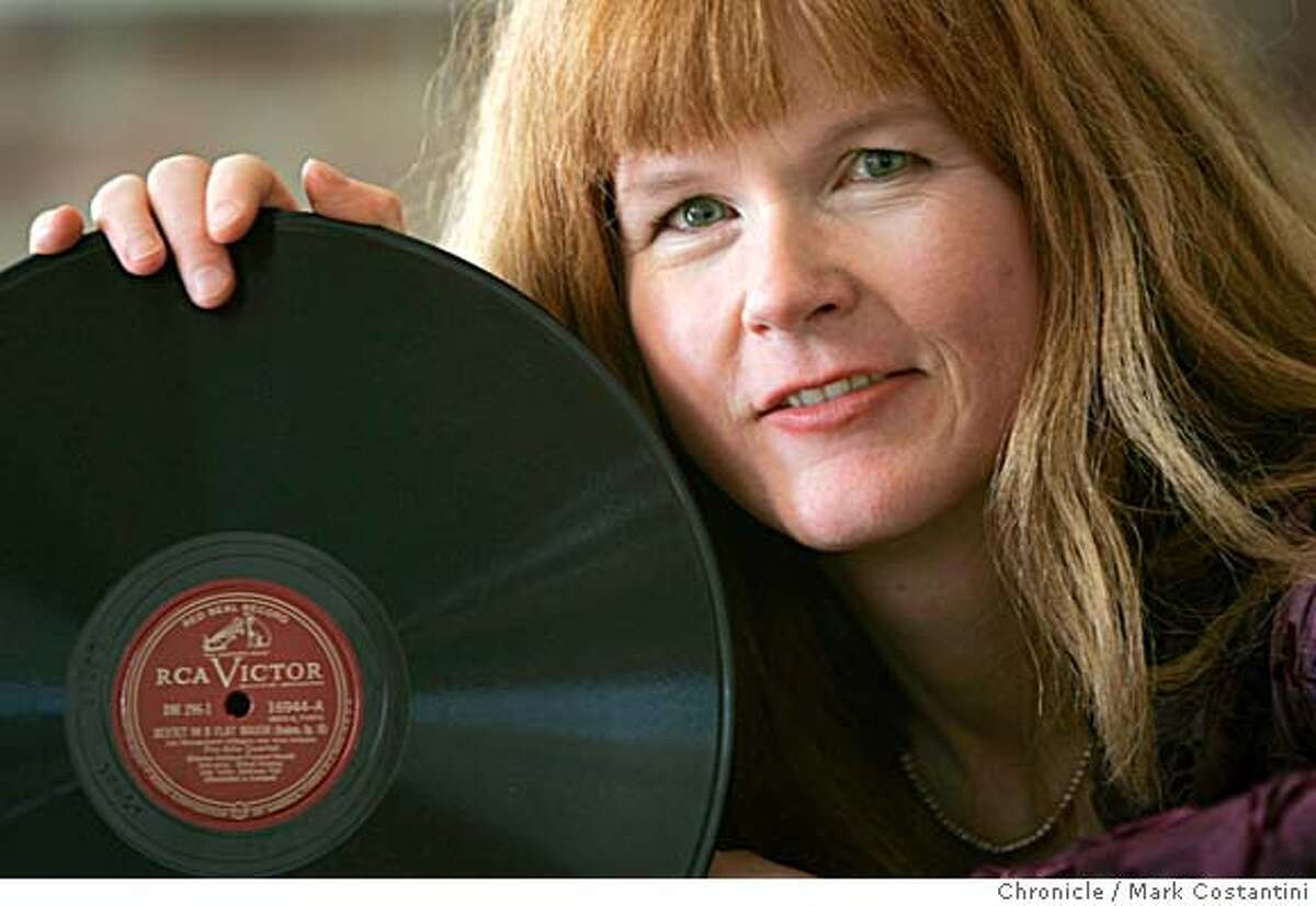 FACETIME26_0417 2/O9/06 Sarah Cahill, 45, is a pianist who hosts Then and Now, a classical music show on KALW-FM Sunday nights. She is also a performer who commissions modern work from composers. She learned about classical music listening to her father's 78s at home, like this Brahms one. This is a horizontal portrait for the Facetime department of the magazine. Photo taken in BERKELEY, CA Photo: Mark Costantini/S.F. ChronicleRan on: 03-26-2006