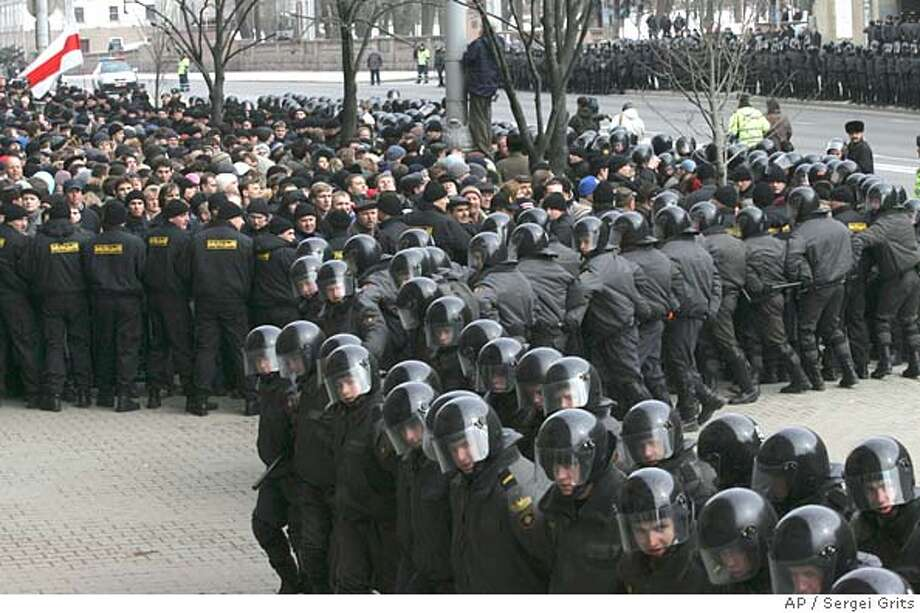 Belarus riot police seal off streets from opposition supporters in Minsk, Belarus, Saturday, March 25, 2006.Rows of riot police on Saturday blocked off a central square where opposition leaders planned a rally over the disputed election in Belarus, pushing crowds away in a massive show of force meant to quash persistent protests against President Alexander Lukashenko, but thousands of demonstrators defiantly gathered in a nearby park.(AP Photo/Sergei Grits) Photo: SERGEI GRITS