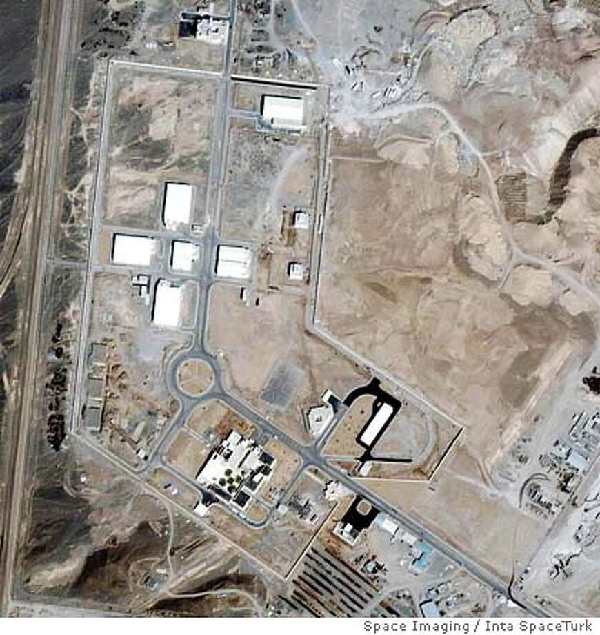** FILE ** This recent undated satellite image provided by Space Imaging/Inta SpaceTurk shows the once-secret Natanz nuclear complex in Natanz, Iran, about 150 miles south of Tehran. Iran broke U.N. seals on its nuclear enrichment facility Tuesday, Jan. 10, 2006 pledging only to conduct research, but the international nuclear watchdog said Tehran also planned small-scale enrichment of uranium _ a process that can produce fuel for nuclear weapons. (AP Photo/Space Imaging/Inta SpaceTurk, HO) Ran on: 01-11-2006  A recent satellite image shows the once-secret Natanz nuclear complex in Natanz, Iran, about 150 miles south of Tehran. Ran on: 01-11-2006  A recent satellite image shows the once-secret Natanz nuclear complex in Natanz, Iran, about 150 miles south of Tehran.Ran on: 03-25-2006  This satellite image shows the Iranian nuclear complex in Natanz, about 150 miles south of the capital, Tehran. Diplomats say Iran has foregone usual testing periods for individual centrifuges, instead appearing to be trying to put together as many as possible. Photo: X