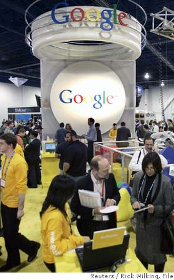 The Google booth is seen at the 2006 Consumer Electronics Show in Las Vegas in this January 5, 2006 file photo. Web search and Internet stock phenomenon Google Inc said profit rose 82 percent as the company generated strong results from the sale of online ads January 31, 2006. REUTERS/Rick Wilking/Files 0 Photo: RICK WILKING