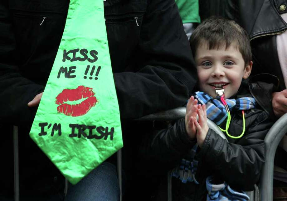 A child smile as he watches the St Patrick's Day festivities in Dublin, Ireland on March 17, 2012. More than 100 parades are being held across Ireland to mark St Patrick's Day, with up to 650,000 spectators expected to attend the parade in Dublin. Photo: PETER MUHLY, AFP/Getty Images / AFP