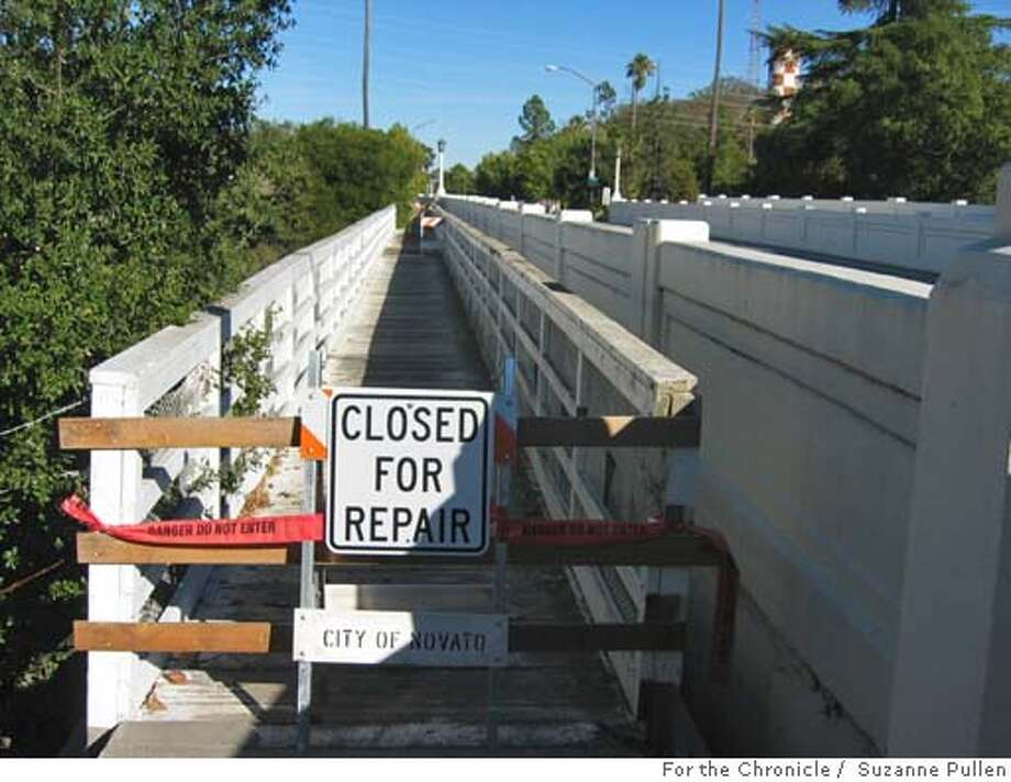 cwhamiltonbridge02.JPG FOR CHRONICLEWATCH USE ONLY: This pedestrian bridge at Hamilton Field on Main Gate Road in Novato has been blocked off for repairs but no evidence of any work is visible. 11/1/04 in N ovato. Suzanne Pullen / The Chronicle Ran on: 11-19-2004 Photo: Suzanne Pullen