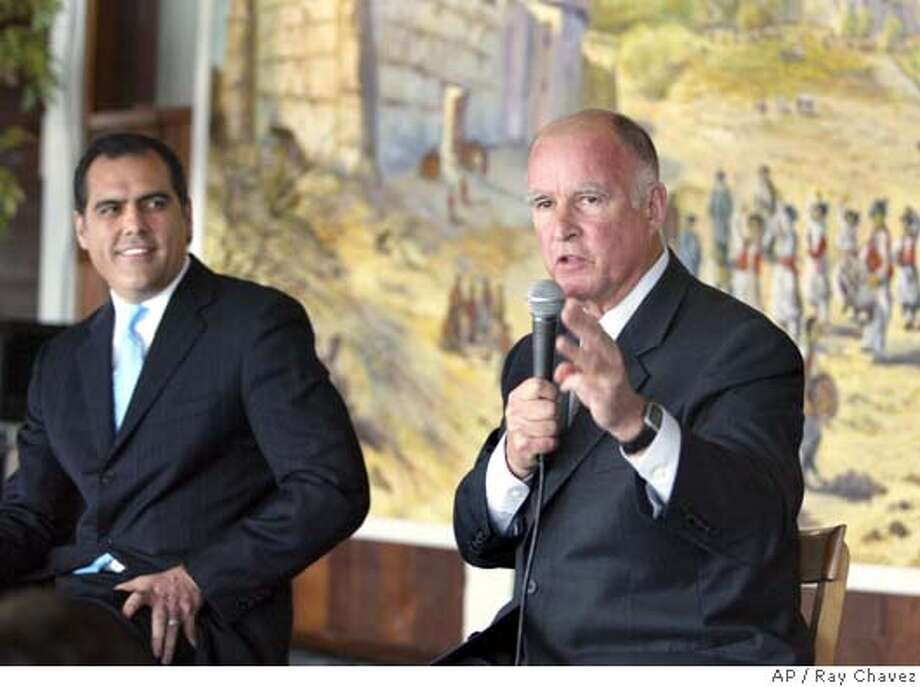 Los Angeles City Attorney Rocky Delgadillo, left, listens to Oakland Mayor Jerry Brown during the candidates' forum for State Attorney General in Oakland, Calif., Friday, March 24, 2006. (AP Photo/The Oakland Tribune, Ray Chavez) ** MANDATORY CREDIT, MAGS OUT ** STAND ALONE, LOCALS PLEASE CREDIT, MAGS OUT Photo: RAY CHAVEZ