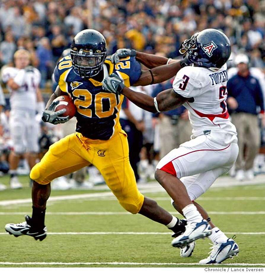 Cal's #20 Justin Forsett and Arizona's #3 Wilrey Fontenot exchange straight arms as Forsett battles his way inside the five-yard line. He late scored a running TD in this 4th quarter drive. CAL defeated ARIZONA 45-27. SEPTEMBER 22, 2007. Lance Iversen/The Chronicle (cq) SUBJECT 9/22/07,in BERKELEY. CA. Photo: By Lance Iversen