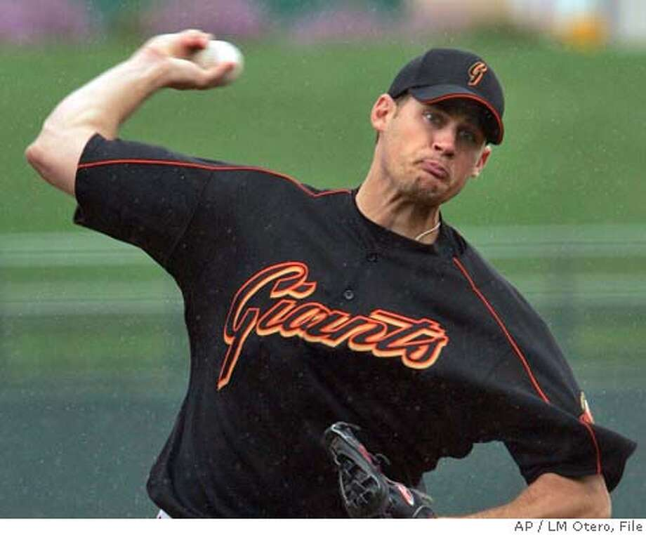 San Francisco Giants starting pitcher Jamey Wright throws in a light drizzle in the third inning against the Kansas City Royals during a spring training exhibition baseball in Surprise, Ariz., Sunday, March 19, 2006. (AP Photo/LM Otero) Photo: LM OTERO