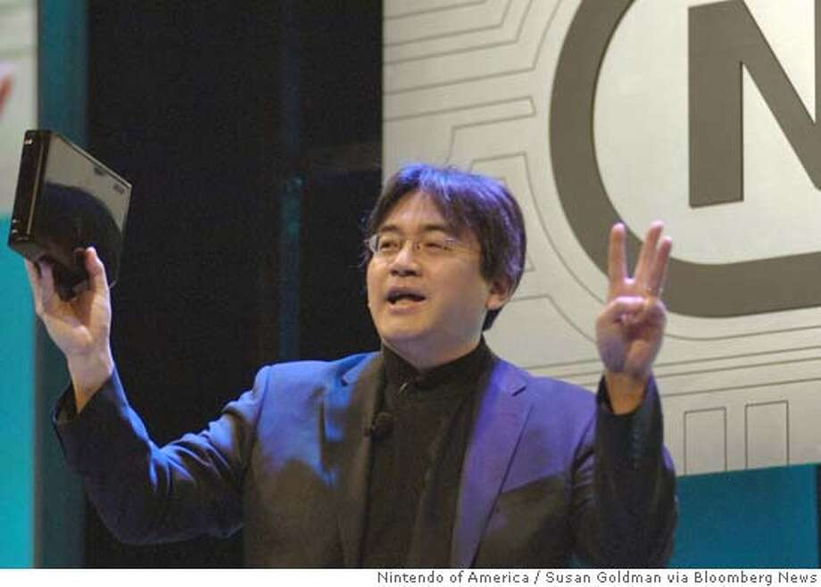 Nintendo President Satoru Iwata explains that Nintendo's new console, code-named Revolution, will be about the size of 3 DVD cases, during a news briefing, Tuesday, May 17, 2005 in the Hollywood area of Los Angeles, California. The compact system, due in 2006, will play 12-centimeter optical discs and Nintendo GameCube discs in a self-loading media bay. Photographer: Susan Goldman. Source: Nintendo of America via Bloomberg News. Photo: SUSAN GOLDMAN