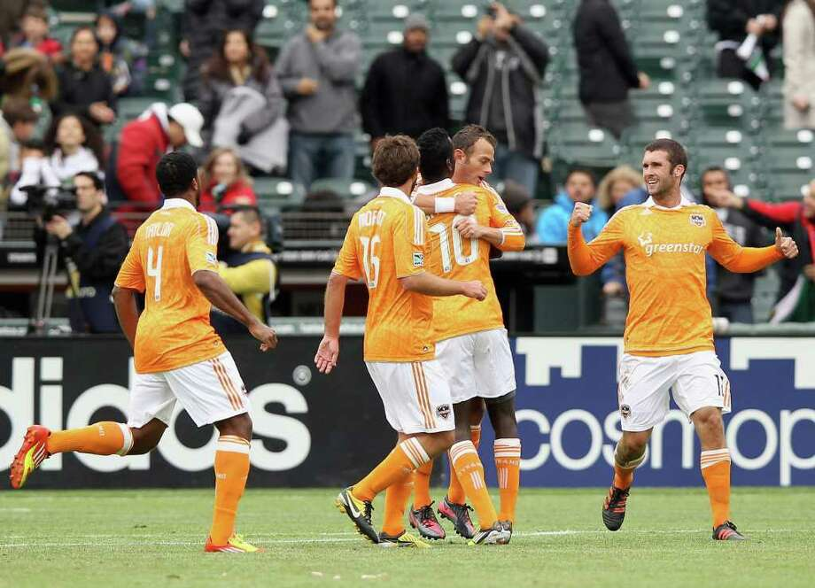 SAN FRANCISCO, CA - MARCH 17:  Brad Davis #11 of the Houston Dynamo is congratulated by teammates after he scored on a penalty kick against the San Jose Earthquakes at AT&T Park on March 17, 2012 in San Francisco, California. Photo: Ezra Shaw, Getty Images / 2012 Getty Images
