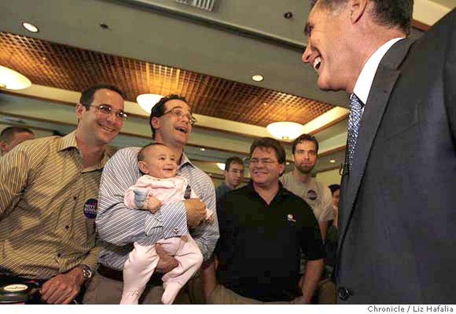 """ROMNEY_153.JPG Former Massachuetts Gov. Mitt Romney (far right), the GOP presidential candidate, is doing an """"Ask Mitt Anything"""" town hall meeting in Santa Clara next to David's restaurant where he greets supporters Glen Gechlik (left), and his twin brother Gary Gechlik (right), and Gary's 4 month old daughter, Sarah Gechlik.  Liz Hafalia/The Chronicle/Santa Clara/9/25/07  **Mitt Romney, Glen Gechlik, Gary Gechlik, Sarah Gechlik. cq �2007, San Francisco Chronicle/ Liz Hafalia  MANDATORY CREDIT FOR PHOTOG AND SAN FRANCISCO CHRONICLE. NO SALES- MAGS OUT. Photo: Liz Hafalia"""