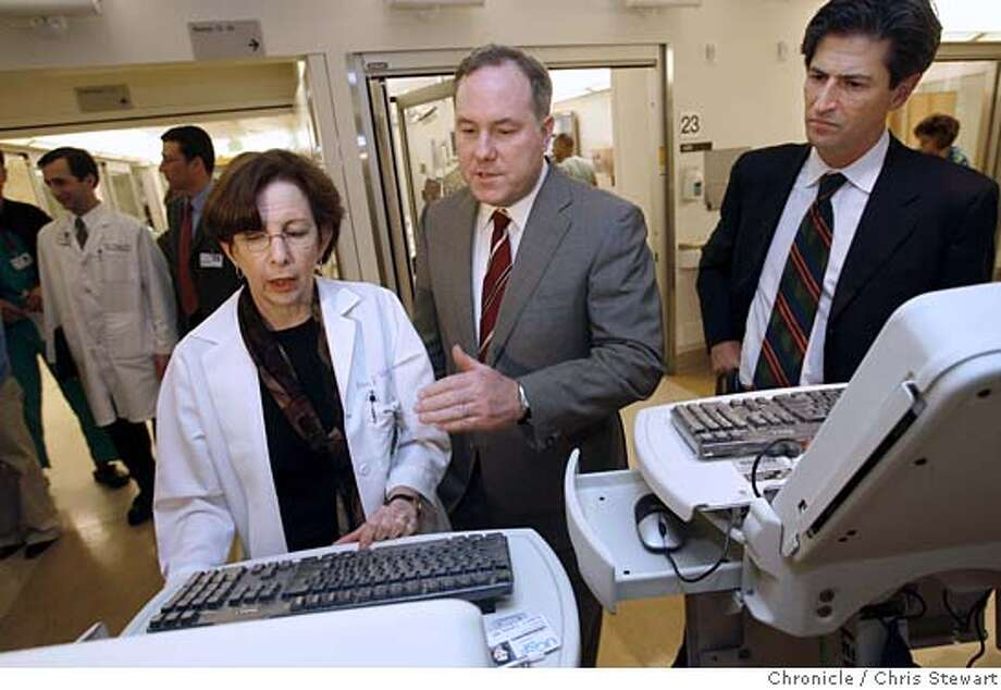 brailerxx_052_cs.jpg Event on 3/17/06 in San Francisco.  Dr. Ellen J. Weber, medical director of the UCSF Emergency Department (left) demonstrates the use of a COW, or computer on wheels, to Dr. David Brailer (center), National Coordinator for Health Information Technology during a visit to UCSF Medical Center at Parnassus, 505 Parnassus Avenue, SF. At right is David Crane, Governor Schwarzenegger's special adviser for jobs and economic growth. Brailer was shown the hospital's efforts at coordinating medical information.  Chris Stewart / The Chronicle MANDATORY CREDIT FOR PHOTOG AND SF CHRONICLE/ -MAGS OUT Photo: Chris Stewart