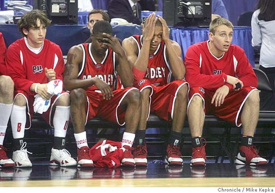 NCAA_COLOR332_mk.JPG Dejected Bradley players #5 Tony Bennett and #22 Lawrence Wright hide their heads during the last seconds of the game against the Memphis Tigers.  The Oakland Arena hosts two NCAA Division 1 Men's Basketball games Thursday. Mike Kepka / The Chronicle Photo: Mike Kepka