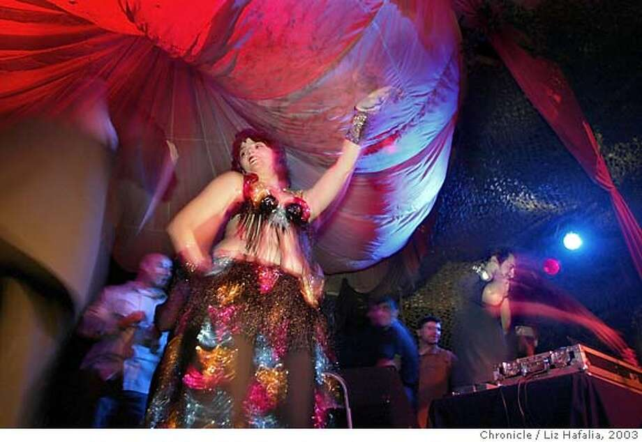 Belly dancer Terry on stage with DJ Nader during 'Mediteranean Nights' at Club Cocomo. (PHOTOGRAPHED BY LIZ HAFALIA/THE SAN FRANCISCO CHRONICLE) Photo: LIZ HAFALIA