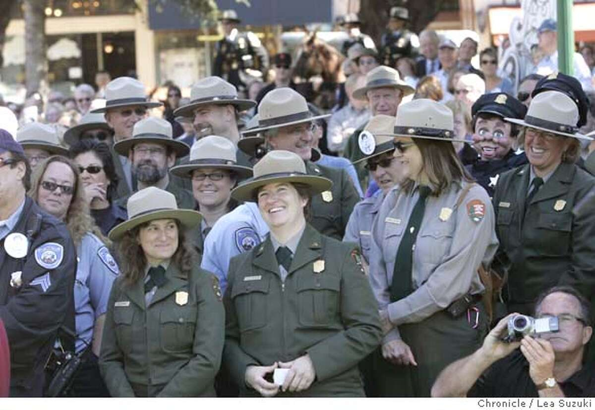 """A group of Park Rangers listen to speakers at """"Camp Farley"""". """"Camp Farley"""", a celebration of the life of Phil Frank, whose cartoons graced the pages of The Chronicle and other newspapers for more than 30 years, in Washington Square Park in San Francisco. Photo by Lea Suzuki/The Chronicle Photo taken on 9/24/07, in San Francisco, CA."""