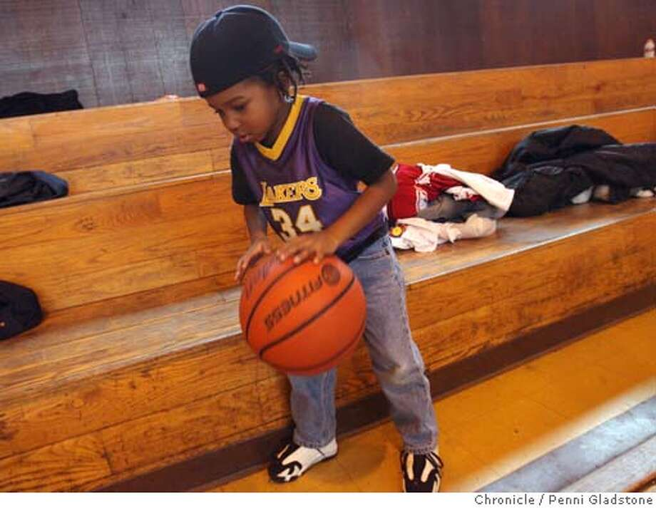 TOURNEY23_HOOPS  Keeping himself occupied is Jaleni Patillo age 4. He came with his father who was playing the hoops at Rainbow Park  With Oakland hosting the NCAA regional championships today, we hit Mosswood Park and other Oakland playgrounds � which have given us the likes of Jason Kidd � to see what the best ballplayers in the city think of it all, and who they see going to the Final Four  Penni Gladstone/The San Francisco Chronicle  Photo taken on 3/23/06, in Oakland, CA. Photo: Penni Gladstone