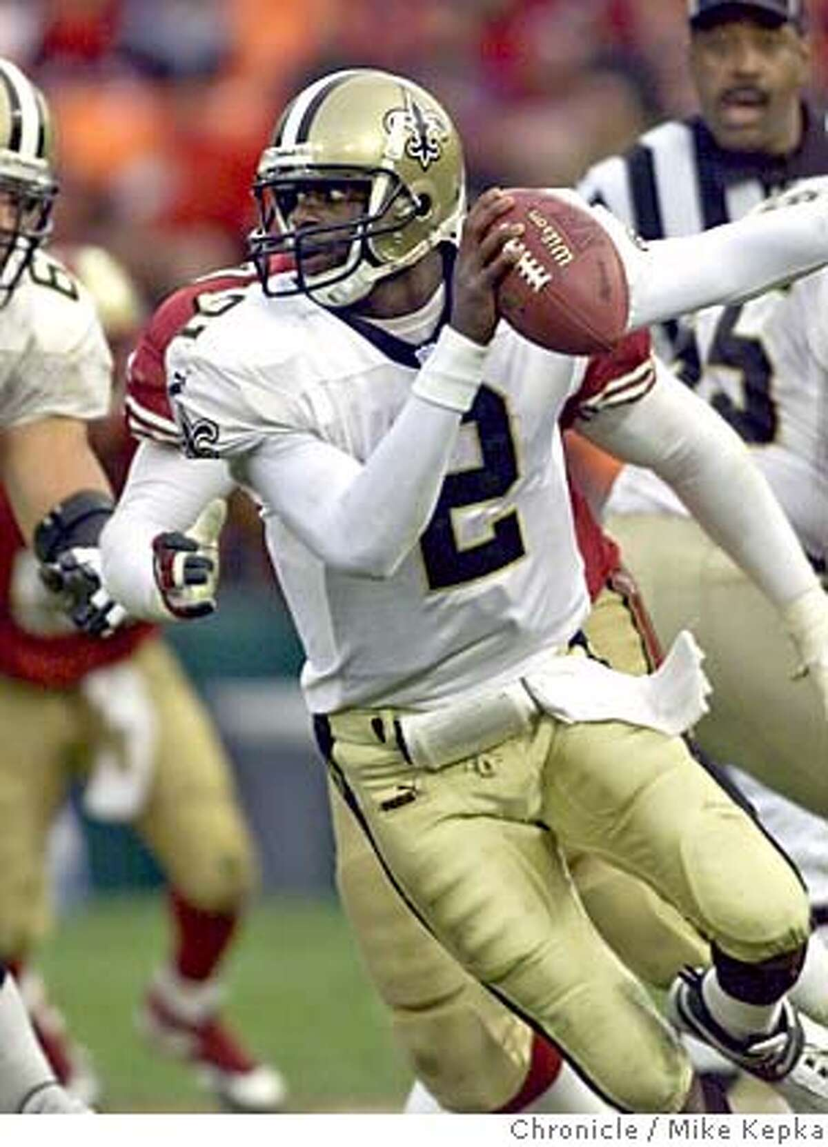 San Francisco 49ers v. New Orleans Saints. Saints QB 2-Aaron Brooks scrambles during 4th quarter action. by Mike Kepka/ The Chronicle