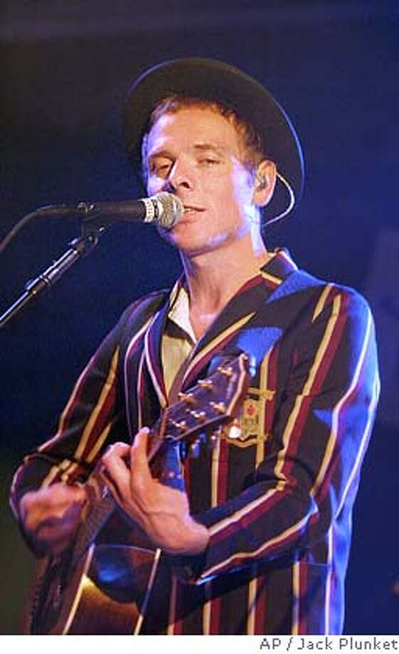 Stuart Murdoch of Belle and Sebastian seamlessly mixed new and vintage tunes at a sold-out show. Associated Press photo by Jack Plunket