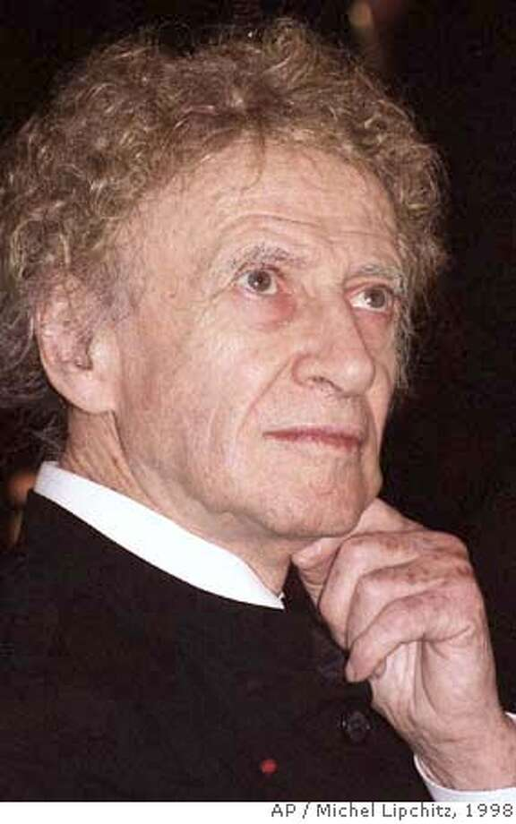 ** FILE ** French pantomime Marcel Marceau looks on during an award giving ceremony in Paris, in this Nov. 24, 1998 file photo. Marceau, who revived the art of mime and brought poetry to silence, has died, French media reported Sunday, Sept. 23, 2007. He was 84. France-Info radio and LCI television said the family had announced the death of Marceau. No other details were released. (AP Photo/Michel Lipchitz, file) NOV 24 1998 FILE PHOTO Photo: MICHEL LIPCHITZ