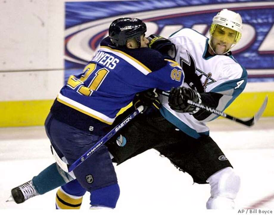 St. Louis Blues' Jamal Mayers, left, pushes San Jose Sharks' Kyle McLaren in the first period of an NHL hockey game Tuesday, March 21, 2006, in St. Louis. (AP Photo/ Bill Boyce) Photo: BILL BOYCE