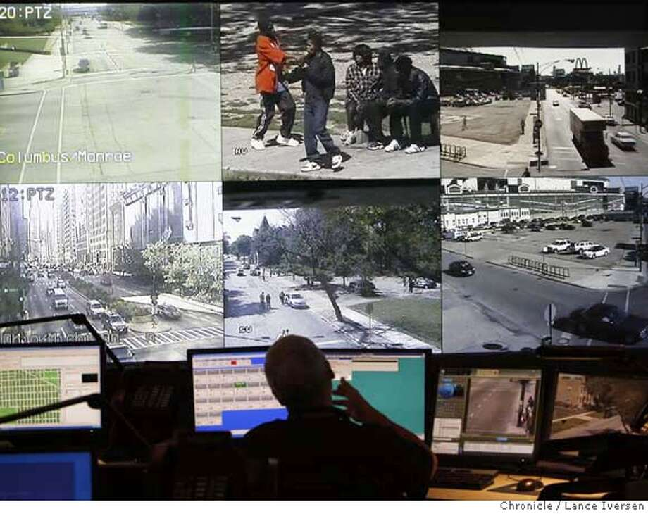 CAMERAS_65666.JPG  Retired Chicago police officers are recruited to join sworn officers to monitor computer displays. The images are projected onto larger screens on the wall at the Chicago Emergency Communication Center so other officers can inter act with any situation. Pod, Police Operation Devices. Dot the landscape throughout Chicago's tourist and troubled areas. With crime up Nationally % 3.7, Chicago is enjoying a % 2.4 drop in crime for the third year in a row. Much of their success is contributed to the cameras that are monitored by sworn officers who can run missions using the cameras or dispatch officers to look at unlawful activity. SEPT 14, 2007. Lance Iversen/The Chronicle (cq) SUBJECT 9/14/07,in CHICAGO. IL. MANDATORY CREDIT PHOTOG AND SAN FRANCISCO CHRONICLE/NO SALES MAGS OUT Photo: By Lance Iversen