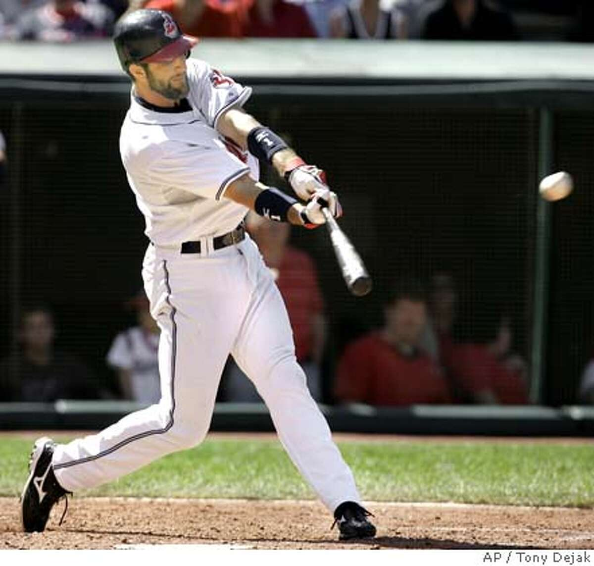 Cleveland Indians' Casey Blake smacks a two-run double off Oakland Athletics pitcher Dallas Braden in the fourth inning, in a baseball game, Sunday, Sept. 23, 2007, in Cleveland. (AP Photo/Tony Dejak)