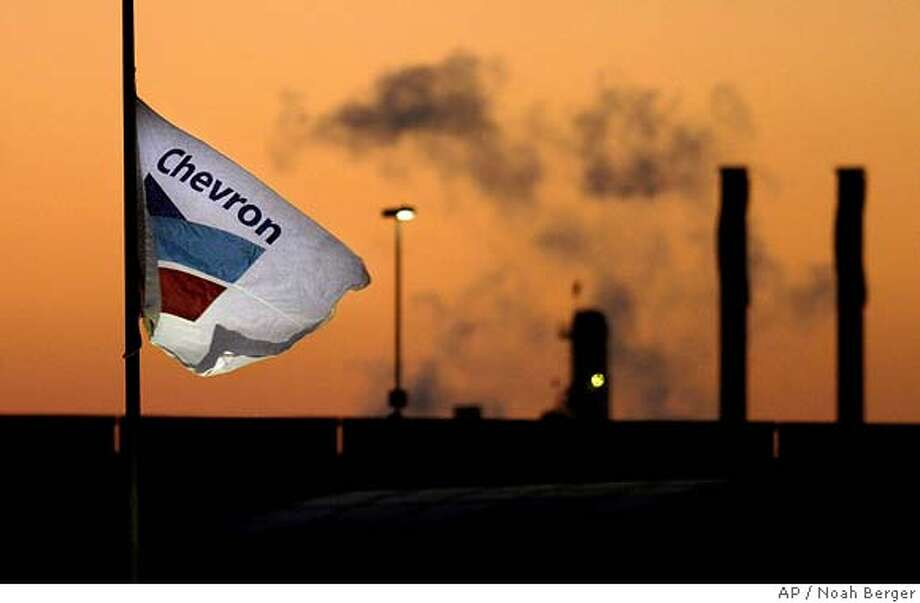 Smoke billows from a ChevronTexaco refinery in Richmond, Calif., on Tuesday, July 26, 2005. The stakes will be higher than usual Friday morning when Chevron Corp. discloses its second-quarter earnings _ the results could deliver a pivotal blow to the company's politically charged battle to buy Unocal Corp. The financial report for the three months ended in June will carry added punch because it's likely to influence the price of Chevron's stock, which is being used to pay for most of the company's Unocal bid, valued at $17.2 billion entering Thursday's trading. (AP Photo/Noah Berger) Ran on: 07-29-2005 Chevron, which owns this Richmond refinery, is trying to persuade Unocal shareholders to accept its bid for the company