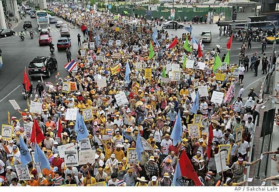 Anti-Thaksin Shinawatra protestors gather in the streets in Bangkok, Thailand, Tuesday, March 21, 2006. Thailand's main opposition party has given Prime Minister Thaksin Shinawatra a Tuesday deadline to take action against alleged electoral fraud by his ruling party or risk exposure of more wrongdoing. (AP Photo/Sakchai Lalit) Photo: SAKCHAI LALIT