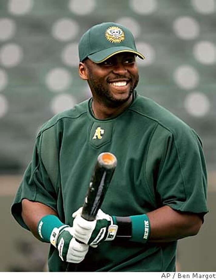 Oakland Athletics' Milton Bradley smiles during batting practice prior to the exhibition spring training baseball game with the Chicago Cubs Monday, March 6, 2006, in Phoenix. (AP Photo/Ben Margot) EFE OUT EFE OUT Photo: BEN MARGOT