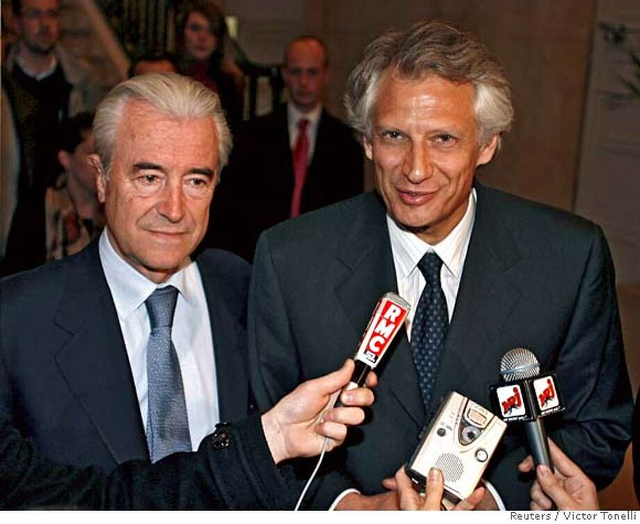 French PM Villepin and Education Minister Robien speak after meeting in Paris Photo: VICTOR TONELLI