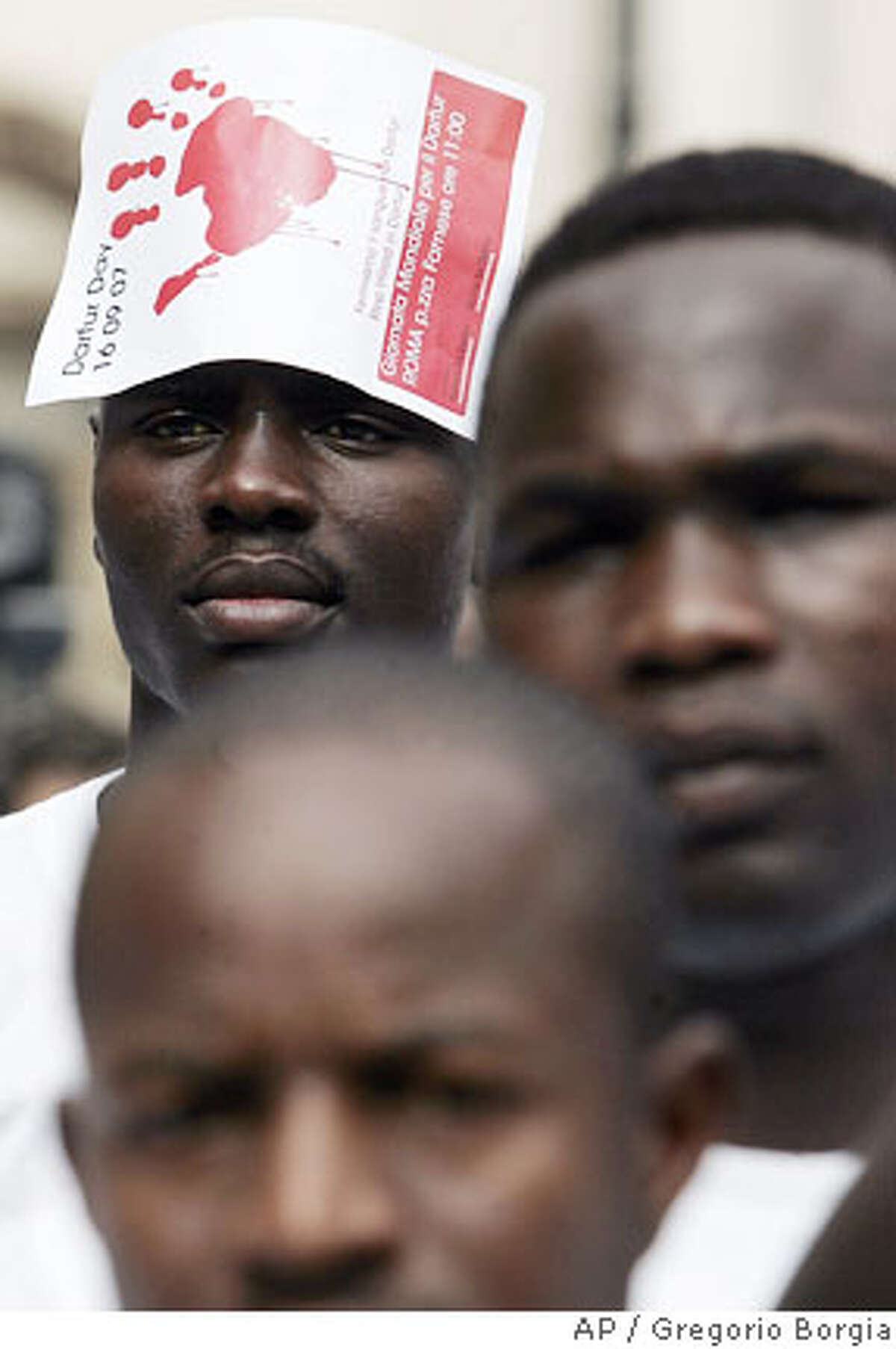Sudanese citizens stage a demonstration to demand an immediate cease-fire in Sudan's Darfur region and the swift deployment of an expanded peacekeeping force there, Rome, Italy, Sunday, Sept. 16, 2007. (AP Photo/Gregorio Borgia)