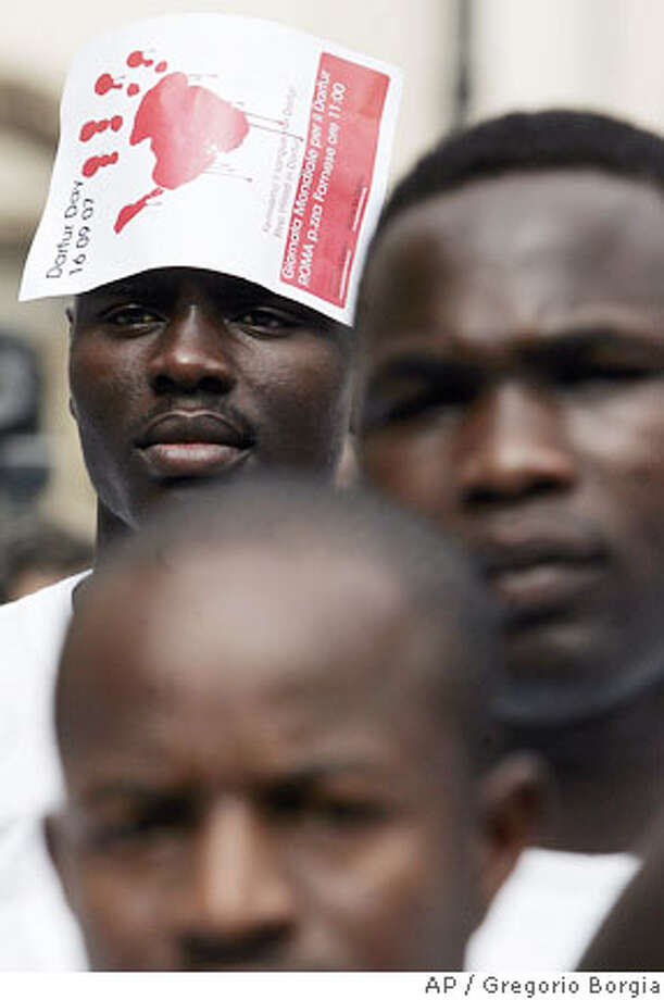 Sudanese citizens stage a demonstration to demand an immediate cease-fire in Sudan's Darfur region and the swift deployment of an expanded peacekeeping force there, Rome, Italy, Sunday, Sept. 16, 2007. (AP Photo/Gregorio Borgia) Photo: GREGORIO BORGIA