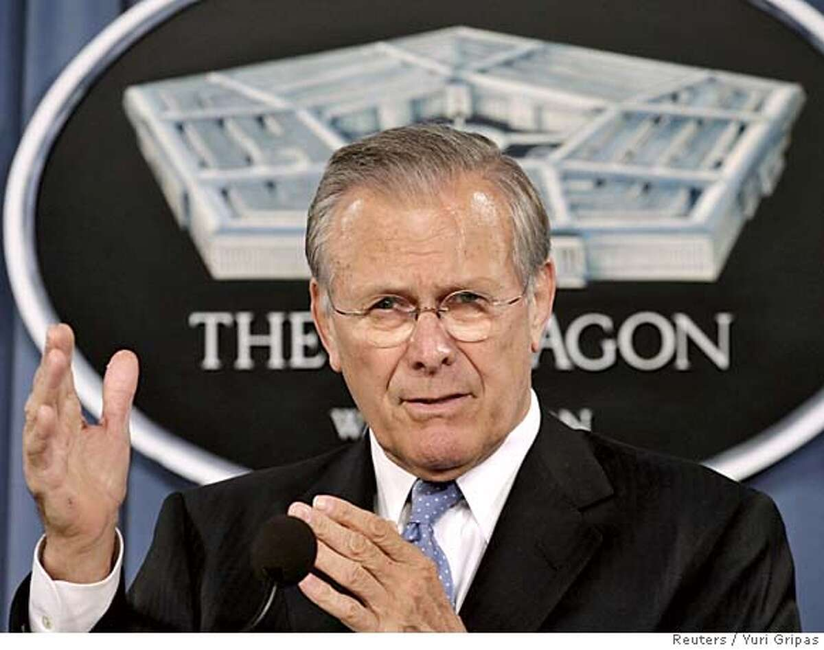 U.S. Secretary of Defense Donald Rumsfeld speaks at a joint news briefing with General Peter Pace, Chariman of the Joint Chiefs of Staff (not in photo), at the Pentagon in Washington March 14, 2006. REUTERS/Yuri Gripas 0